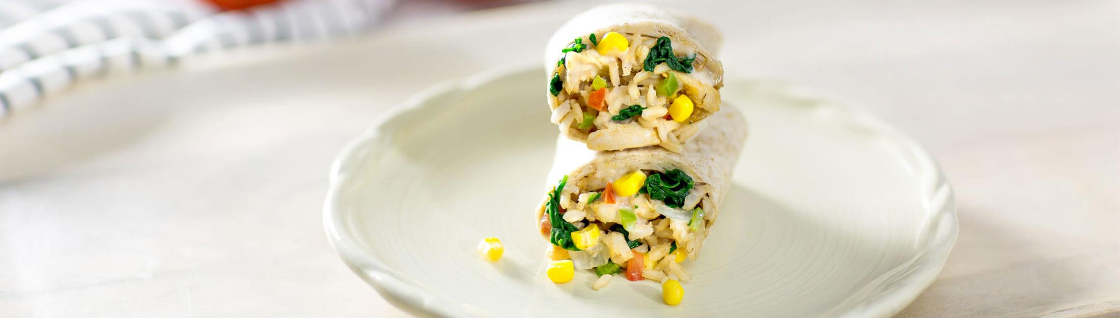 Good Food Made Simple breakfast burritos on a plate.