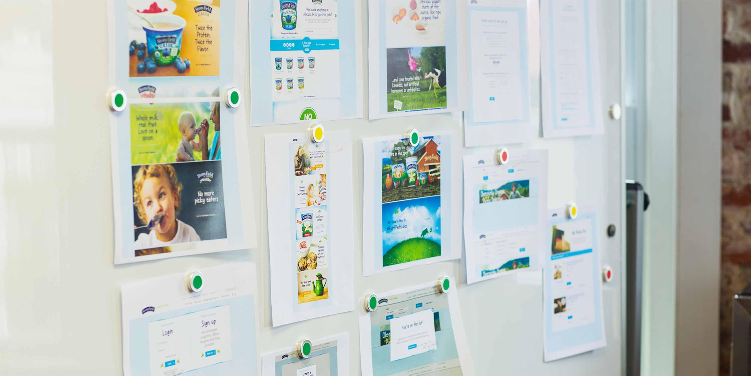 Storyboards hung on the wall showing the Stonyfield website.